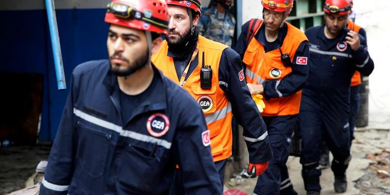 epa04722497 Members of a rescue team from Turkey arrive at the site of earthquake in Kathmandu, Nepal, 27 April 2015. The death toll from the 7.8-magnitude earthquake at the weekend in Nepal was 3,432, the Interior Ministry said 27 April, after thousands more spent a second night in the open. The government said around 6,505 people were injured in the quake that hit on Saturday. Besides the fear caused by numerous aftershocks, people camping in open spaces were suffering a combination of rain, h