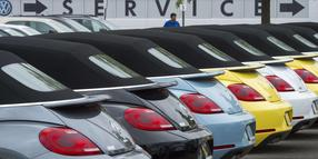 The current version of the Volkswagen Beatle automobiles are lined up for sale at Northern Virginia dealer in Woodbridge, Virginia on September 29, 2015.  Wall Street stocks dropped for the week despite some improving US data as worries ranging from a slowing Chinese economy to the Volkswagen emissions scandal dampened sentiment. Volkswagen came under pressure after reports surfaced concerning the manipulation of values of emission in VW vehicles equipped with diesel engines.  AFP PHOTO/PAUL J.