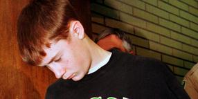 """FILE - In this May 22, 1998, file photo, Thurston High School student , 15, is led to his arraignment in Eugene, Ore. Kip Kinkel, who killed his parents before going on a shooting rampage at his Oregon high school in 1998, killing two classmates and injuring 25 more, has given his first news interview, telling HuffPost he feels """"tremendous, tremendous shame and guilt.""""(, File)"""