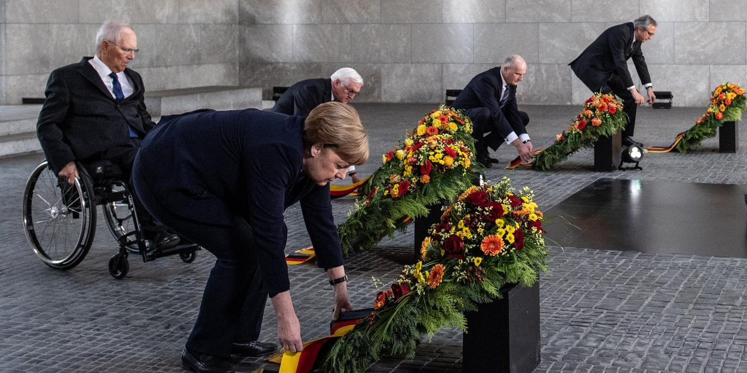 Angela Merkel, President of the German Parliament Bundestag Wolfgang Schaeuble, German President Frank-Walter Steinmeier, President of the Federal Council Bundesrat in Germany Dietmar Woidke and the presiding judge of the German Federal Constitutional Court's second senate, Andreas Vosskuhle attend wreath-laying ceremony to mark the 75th anniversary of the end of World War Two, at the Neue Wache Memorial on May 8, 2020 in Berlin, Germany. (Photo by Filip Singer - Pool/Getty Images)