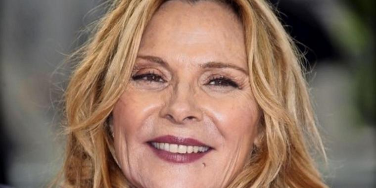 """FILE - In this May 14, 2017, file photo, actress Kim Cattrall poses for photographers upon arrival to the British Academy Television Awards at the Royal Festival Hall in London. """"Sex and the City"""" star Cattrall and Canadian police said Sunday, Feb. 4, 2018, her missing brother has been found dead. (Photo by Joel Ryan/Invision/AP, File)"""